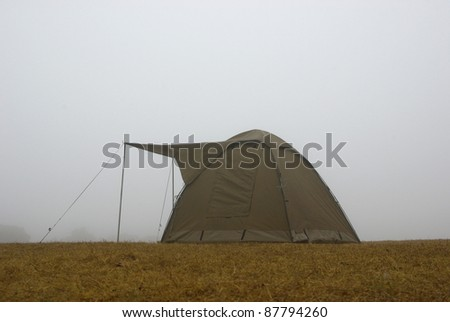Image of a camping tent in the fog