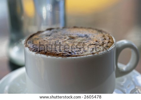 Image of a cappuccino in a white cup. - stock photo