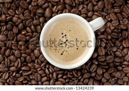 Image of a Cappuccino on coffee beans - stock photo