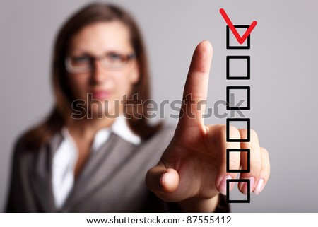 Image of a check list with red mark - stock photo