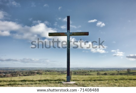 image of a christian cross of christ in a field