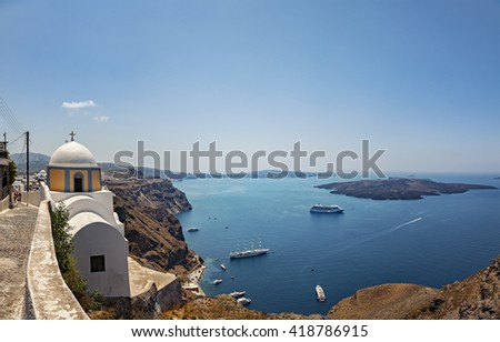 Image of a cliffside church with breathtaking veiws. Santorini, Greece.  - stock photo