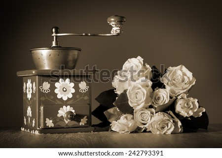 Image of a coffee grinder with flowers sepia colored - stock photo