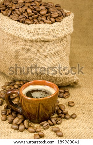 image of a cup of coffee and a sack with coffee beans