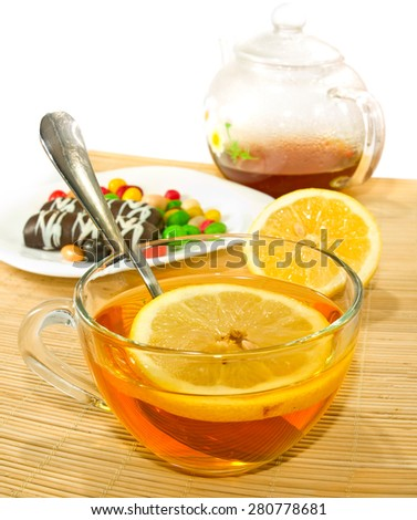 image of a cup of tea and cookies - stock photo
