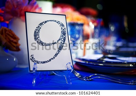 Image of a custom printed table number identifying banquet table - stock photo