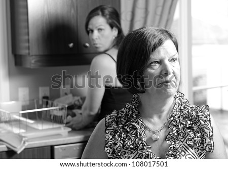 Image of a daughter looking concerned for her mother - stock photo