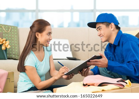 Image of a delivery man asking for a client�¢??s signature  - stock photo