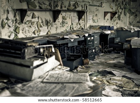 Image of a destroyed office in a derelict abandoned police station.