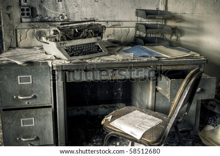 Image of a destroyed office in a derelict abandoned police station. - stock photo