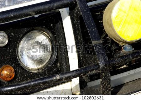 Image of a dirty safari off-road car detail - stock photo