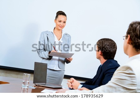 image of a discusses business woman with colleagues