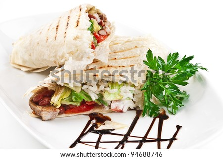 image of a doner kebab on a white plate