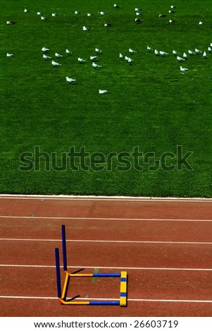 image of a fallen hurdle, symbol of a finished race or a failure - stock photo