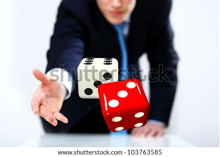 Image of a flying dice as symbol of risk and luck - stock photo