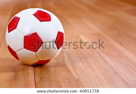 Image of a football lying on a wooden floor - stock photo