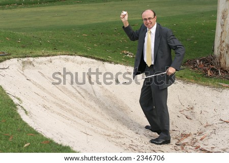 Image of a frustrated golfer in business attire - stock photo