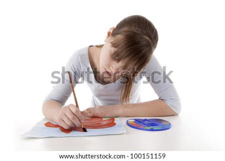 Image of a girl drawing color flower