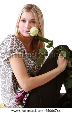 Image of a girl sitting with yellow rose
