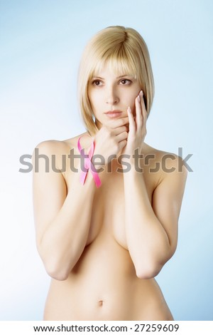Image of a girl with a pink ribbon in her hand - stock photo