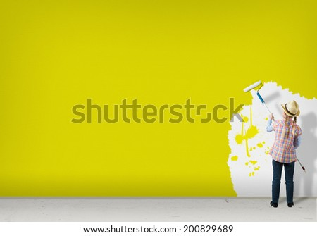 image of a girl with hat roller wall paints - stock photo