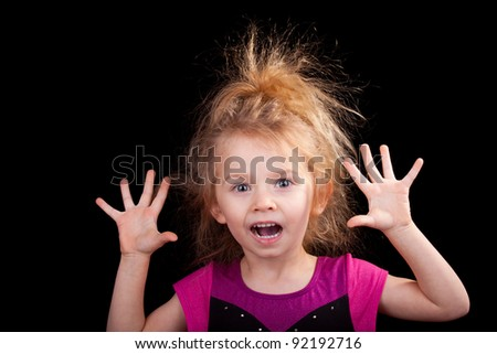 Image of a girl with her hands up. - stock photo