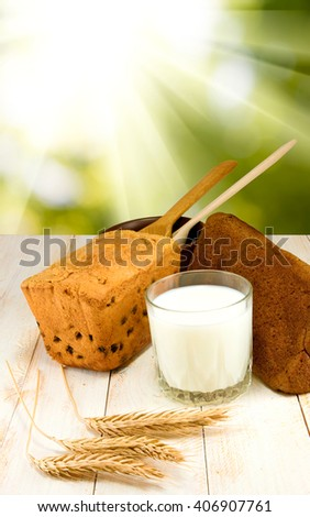 image of a glass of milk, cake and wheat close up - stock photo
