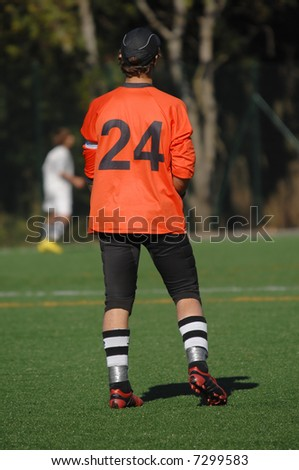 Image of a goalkeeper whatching the game - stock photo