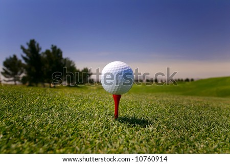 Image of a golf ball on red tee in Vegas - stock photo