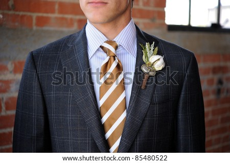 Image of a Gray Plaid suit with tan stripes and boutonniere - stock photo
