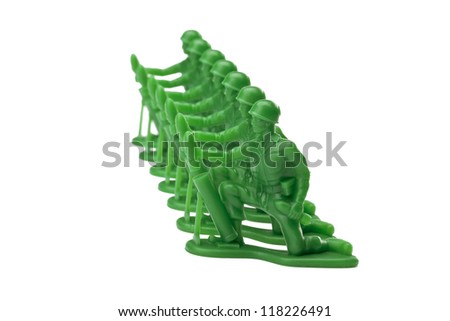 Image of a green military toy soldiers kneeling on a white background - stock photo