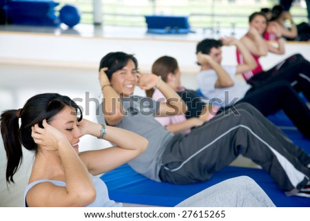 Image of a group working out their abs - stock photo