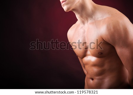 Image of a handsome athletic man on black background - stock photo