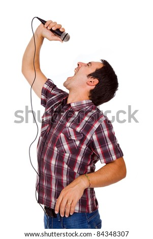 Image of a handsome young man singing to the microphone, isolated on white - stock photo
