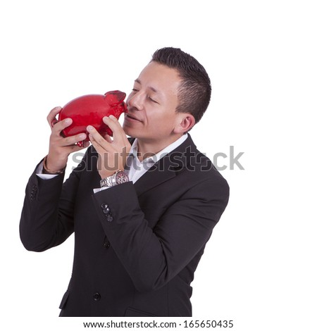 Image of a handsome young mixed race businessman kissing his piggy bank
