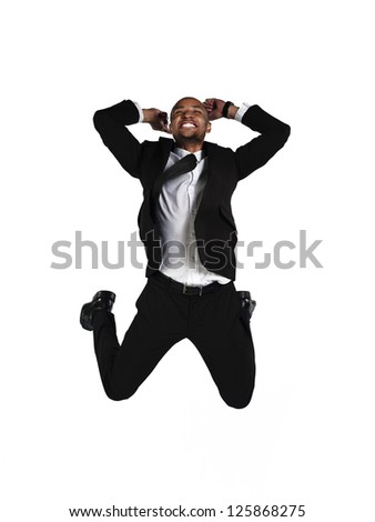 Image of a happy businessman jumping in air over white background - stock photo
