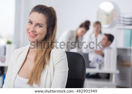 Image of a happy pregnant woman working in a corporation