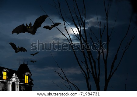 Image of a haunted house with bats flying around