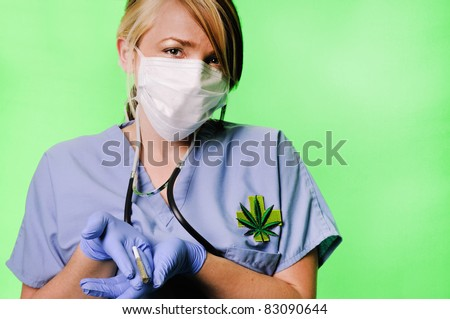 Image of a healthcare professional wearing surgical scrubs, stethoscope and mask presenting a marijuana joint on a chroma key background