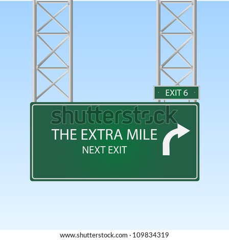 "Image of a highway sign with an exit to ""The Extra Mile"" against a blue sky background. - stock photo"