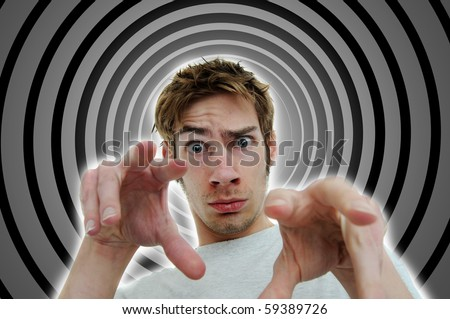 Image of a hypnotist brainwashing the viewer into a deep subconscious subliminal trance using secret mind control tactics. - stock photo