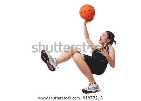 Image of a lady basketball player shooting a ball.Isolated in white background. - stock photo