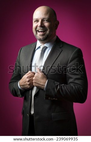 image of a laughing business man with a magenta background