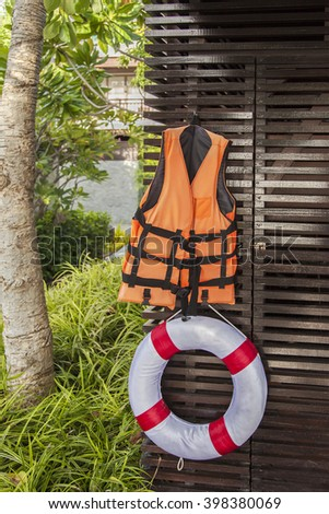 Image of a life jacket and life buoy.  - stock photo