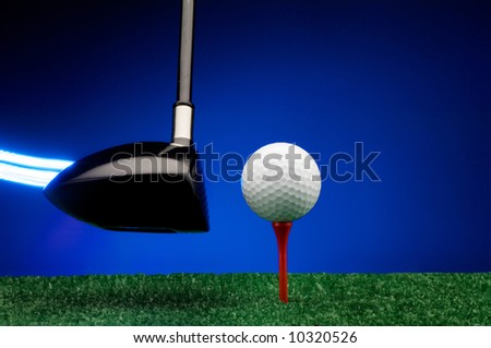 Image of a Light streak trailing Golf wood about to strike ball - stock photo