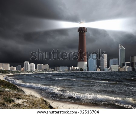 Image of a lighthouse with a strong beam of light - stock photo