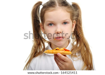 Image of a little girl eating pizza close-up - stock photo