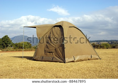 Image of a lonely tent in the wild - stock photo