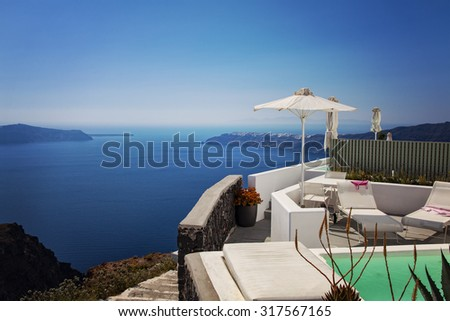 Image of a luxury balcony terrace with an ocean view. Santorini, Greece.  - stock photo