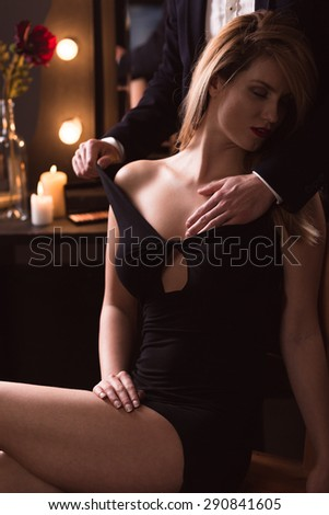 Image of a male delicate touching womans breast - stock photo